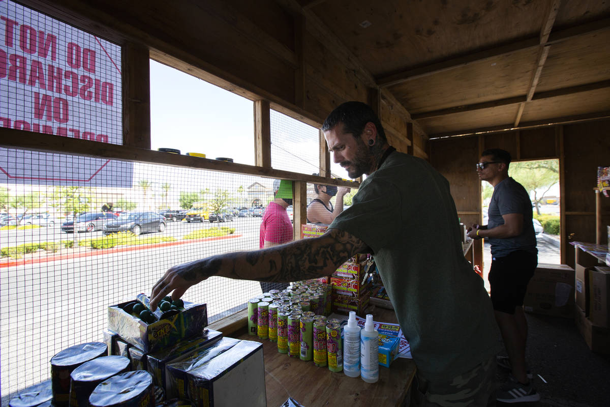 Jeremiah Wicker and Floyd Ellis gather fireworks for customers in the booth for Freedom House S ...