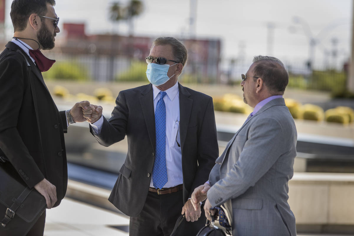 Attorney Andrew Marcantel, left, greets Douglas Haig with attorney Marc Victor as they arrive f ...