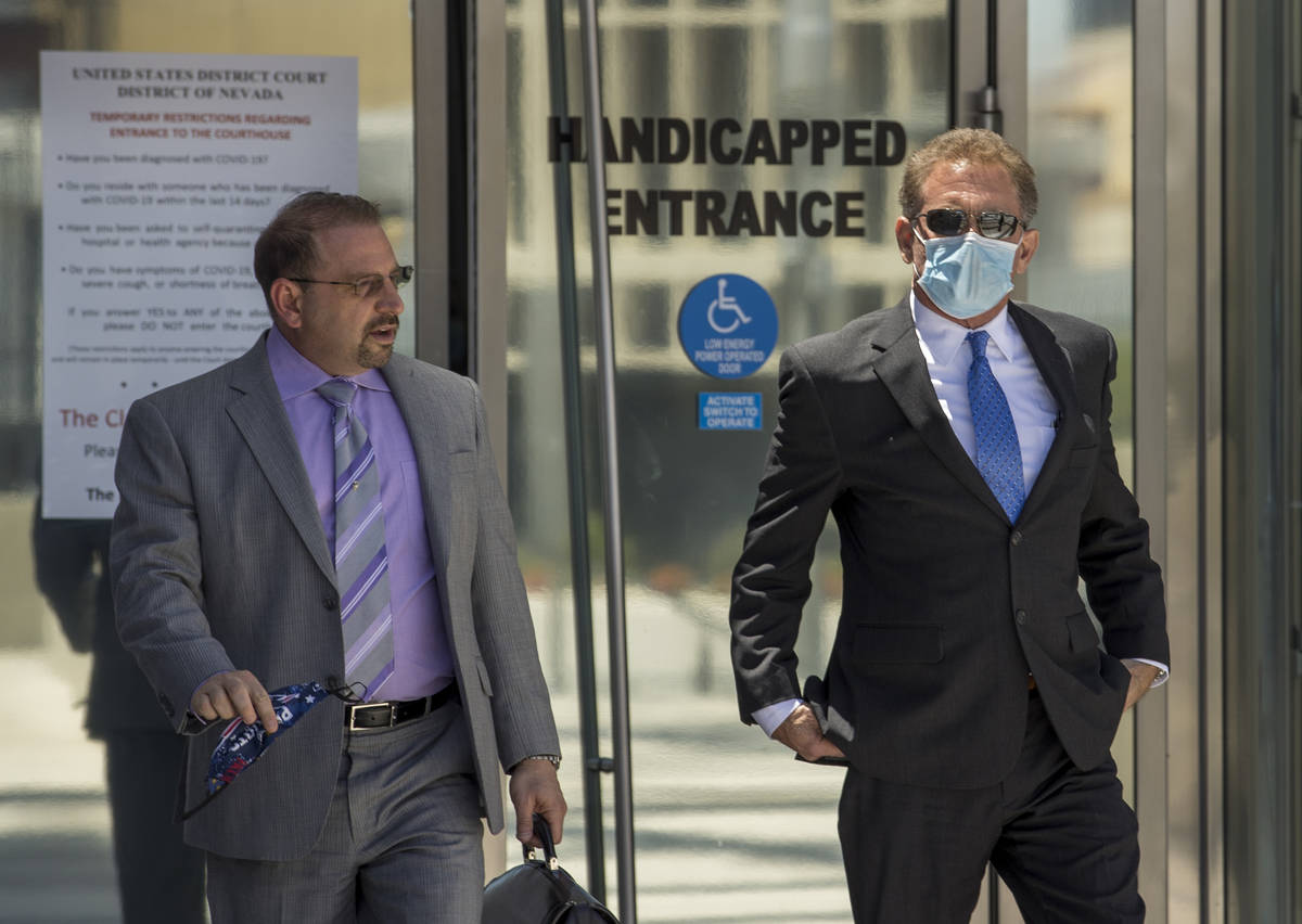 Attorney Marc Victor, left, walks outside with his client Douglas Haig after sentencing at the ...