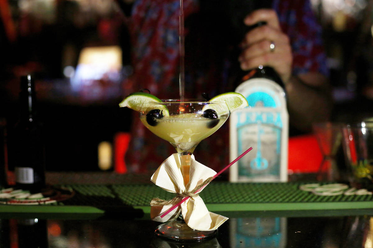 A Baby Yoda cocktail is made at the Golden Tiki in Las Vegas on Monday, Dec. 23, 2019. Elizabet ...