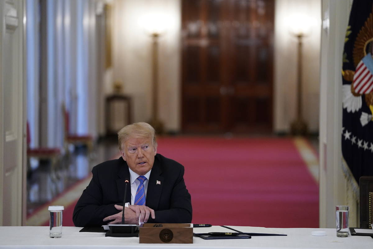 President Donald Trump listens during a meeting with the American Workforce Policy Advisory Boa ...