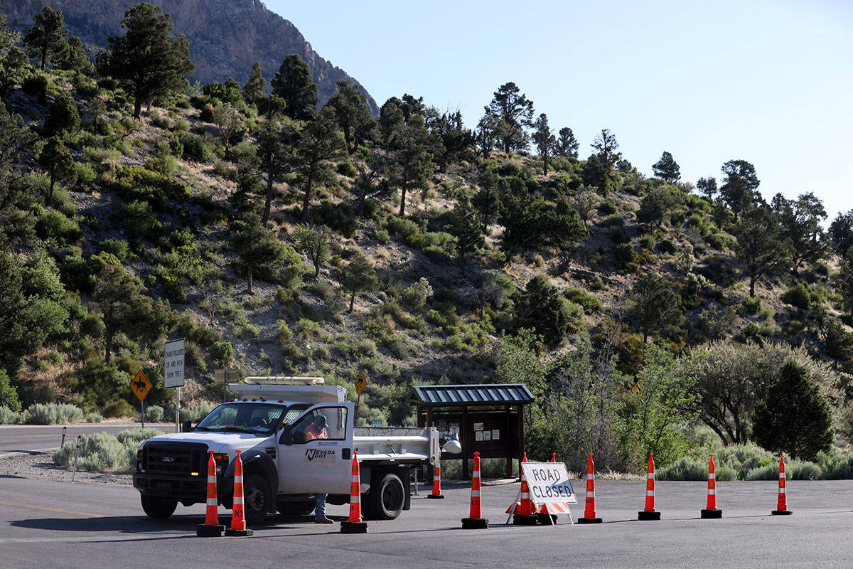 State Route 158, also known as Deer Creek Road, is closed at Kyle Canyon Road as firefighters b ...