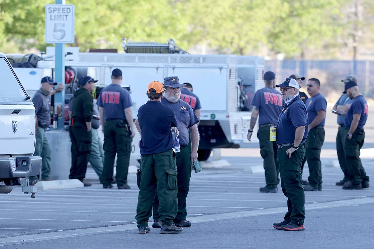 Firefighters from different agencies gather at Centennial High School in Las Vegas as they prep ...