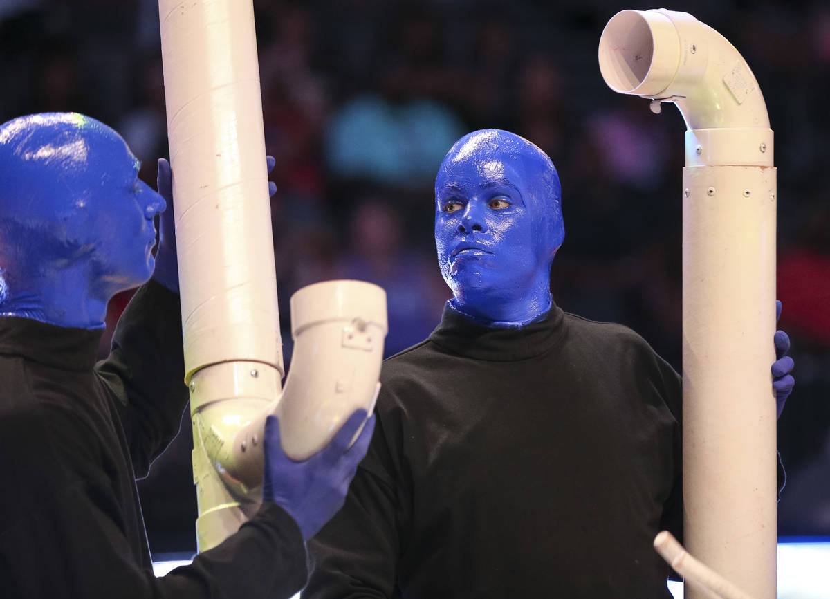 Blue Man Group take part in a half time performance at center-court during the Las Vegas Aces a ...