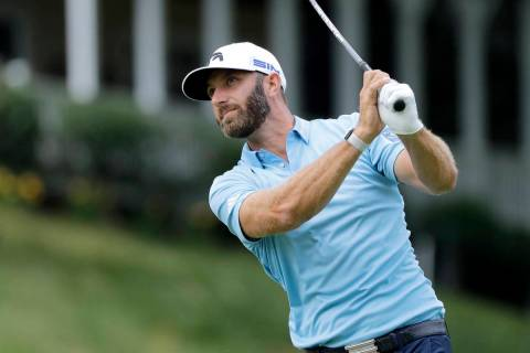 Dustin Johnson tees off on the 18th hole during the final round of the Travelers Championship g ...