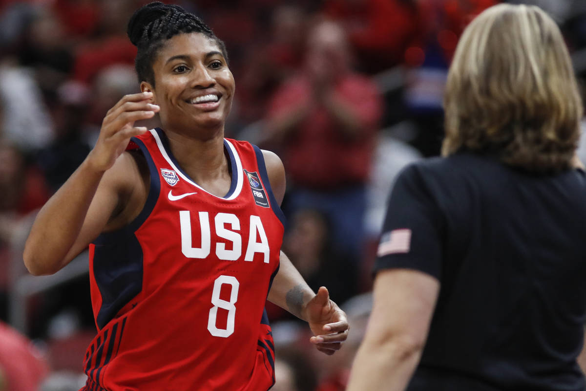 USA Women's National Team forward Angel McCoughtry (8) smiles a she comes off the court during ...