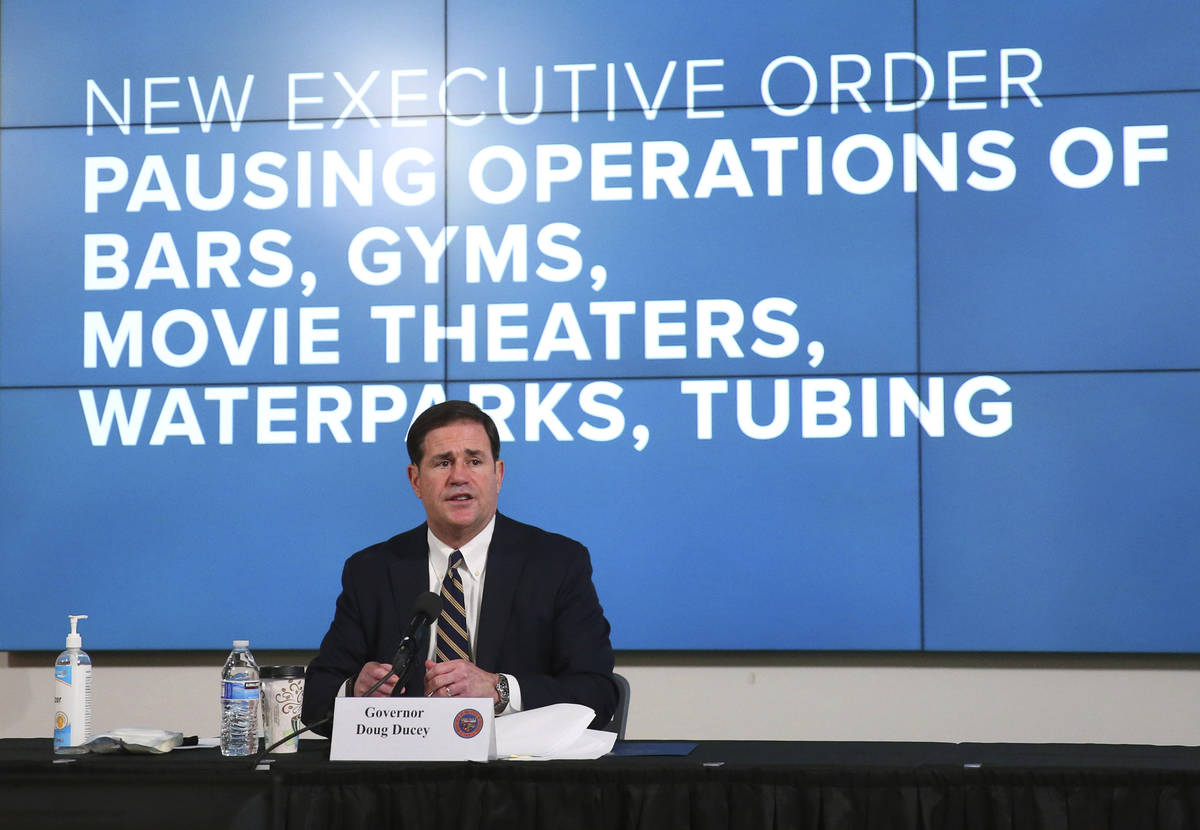 Arizona Gov. Doug Ducey announces a new executive order in response to the rising COVID-19 case ...