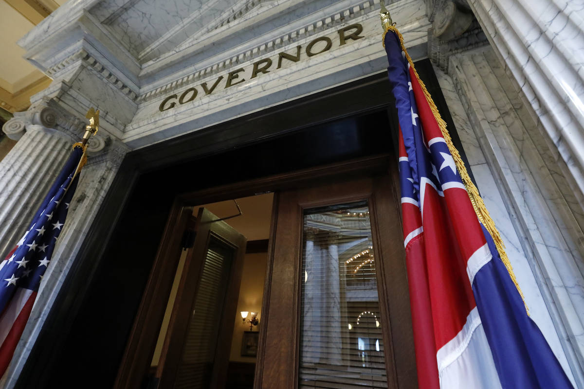 The Mississippi state flag is shown across from the American flag, outside the Governor's Offic ...