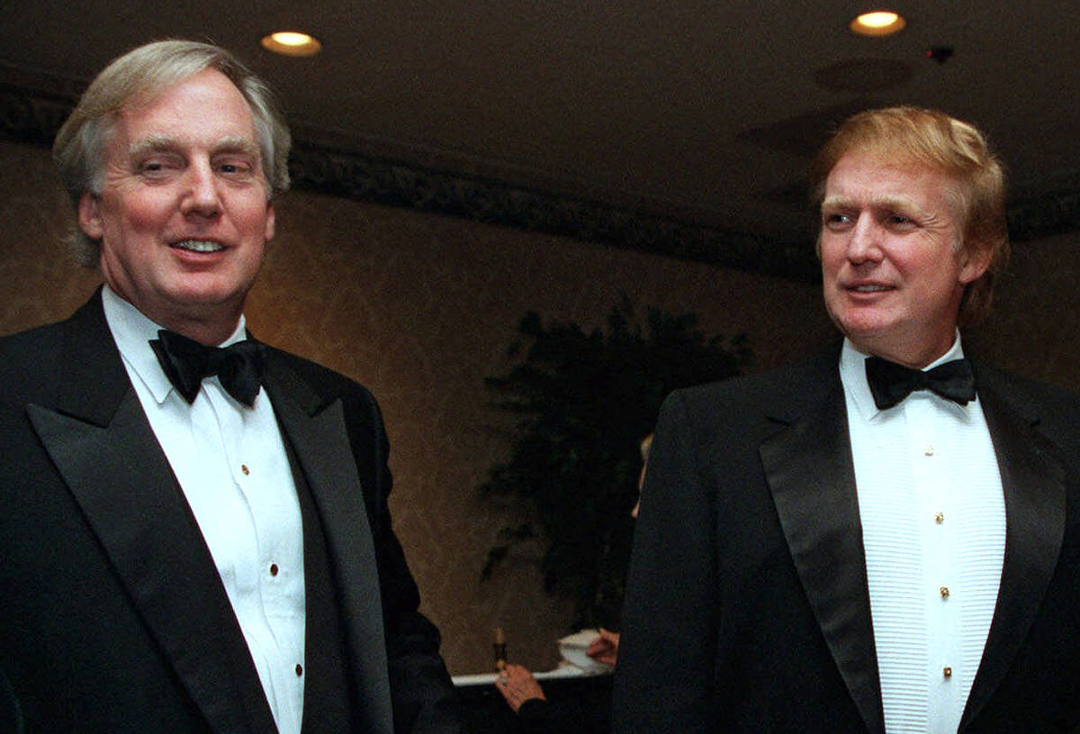 FILE - In this Nov. 3, 1999 file photo, Robert Trump, left, joins real estate developer and pre ...
