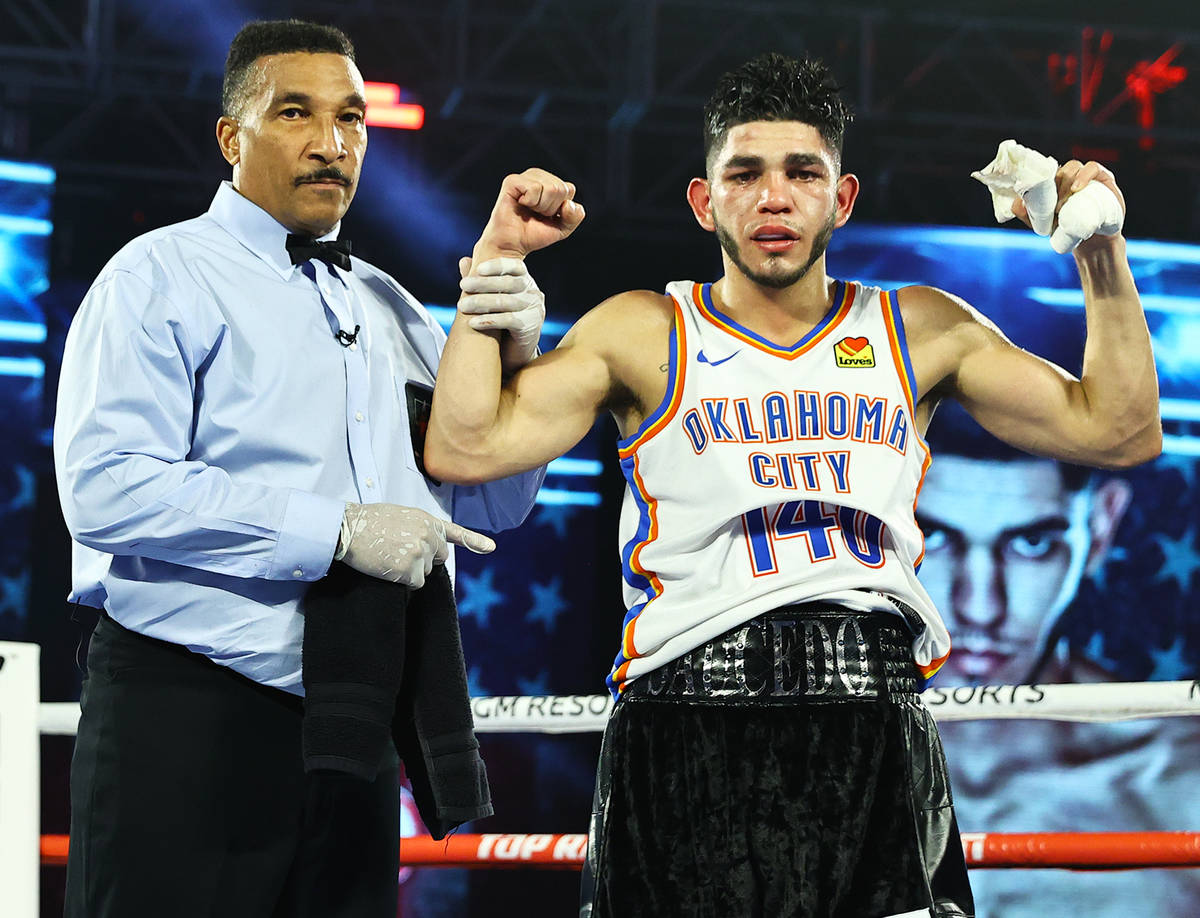 Junior welterweight Alex Saucedo celebrates his victory over Sonny Fredrickson on Tuesday night ...