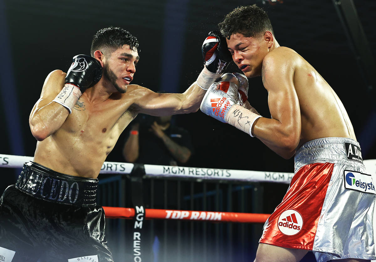 Junior welterweight Alex Saucedo delivers a jab against Sonny Fredrickson on Tuesday night at t ...