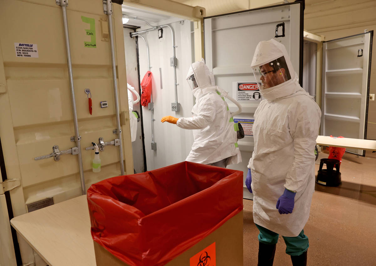 Workers prepare to decontaminate face masks at the Battelle Critical Care Decontamination Syste ...