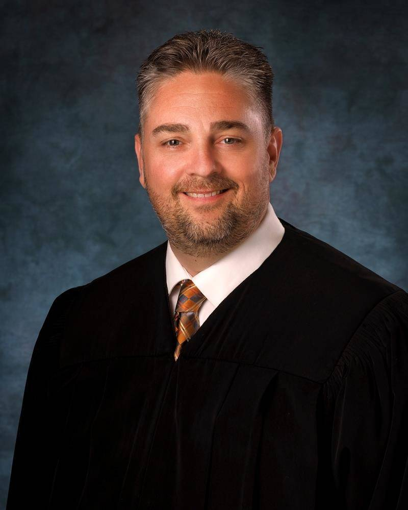 David Gibson, Jr., who was a hearing master, awarded Aaron to his father, Paul Jones, despite r ...