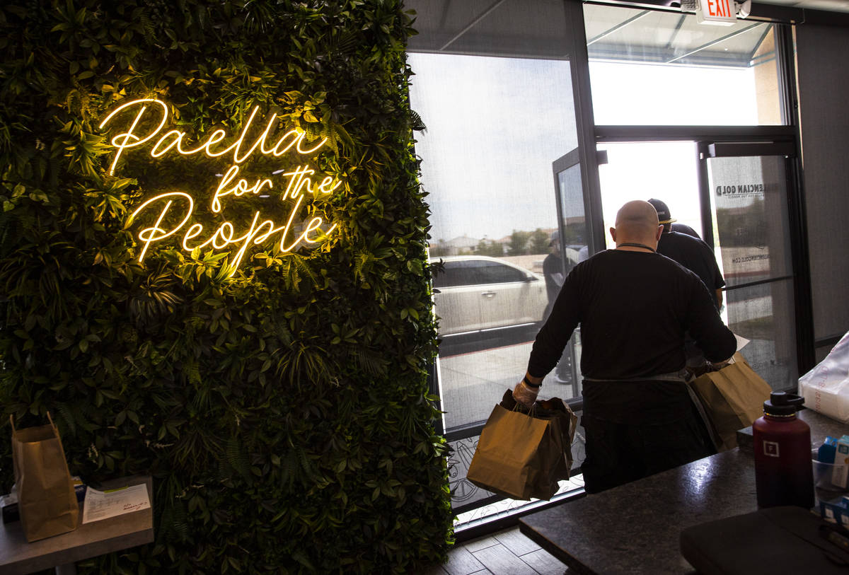 Jeffrey Weiss, Paras Shah, co-owners and co-chefs at Valencian Gold, bring out meals for Delive ...