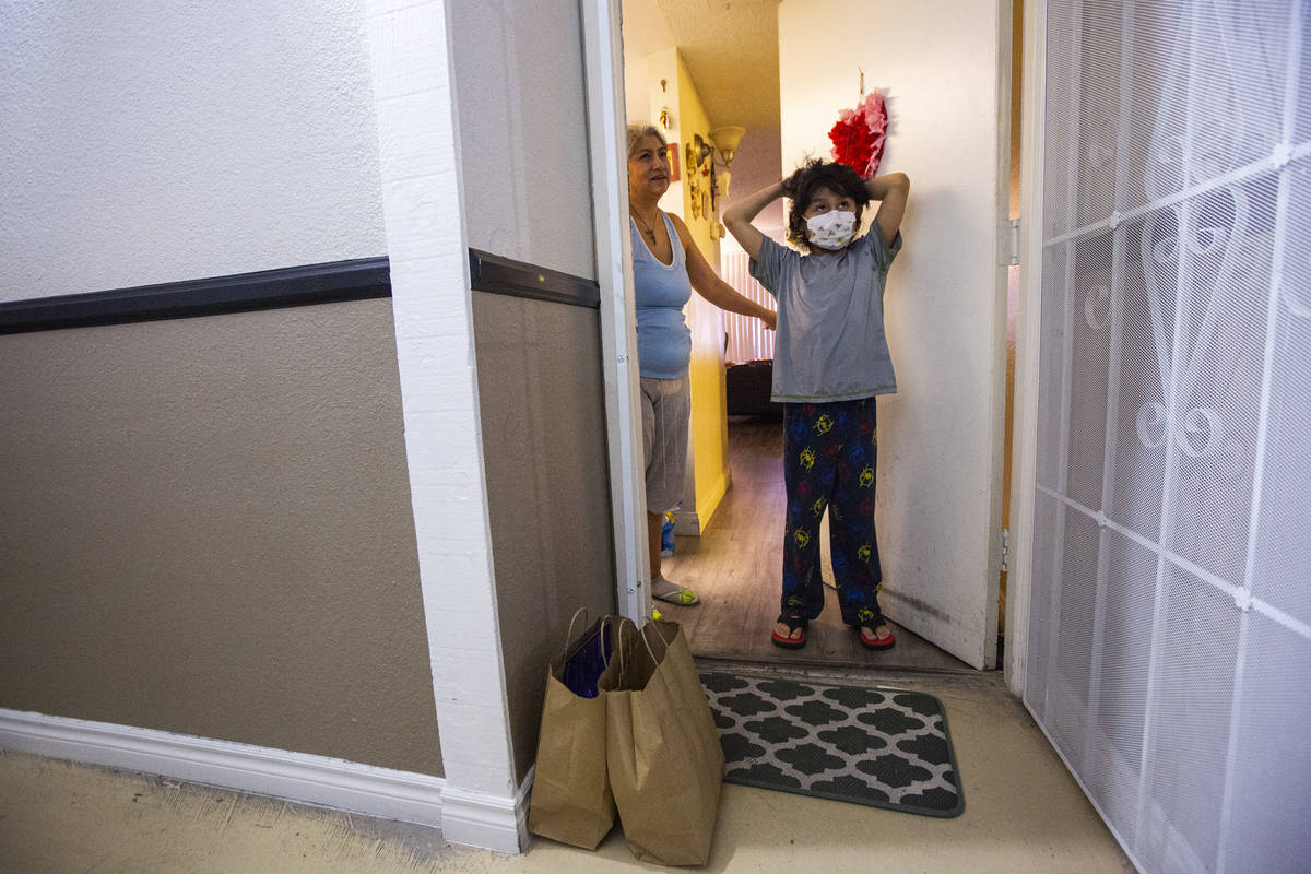 Aiden Pina, 9, talks about his favorite meals from Delivering With Dignity in Las Vegas on Frid ...