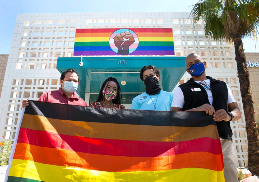 Vince Collins, right, director of Operations at The Gay and Lesbian Community Center of Souther ...
