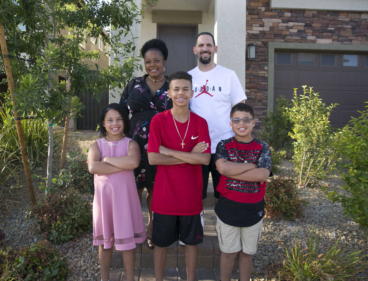 Tyvasha Celano, left, her husband Mike and their children, Kya, 10, Joey, 13, and Alac, 10, in ...