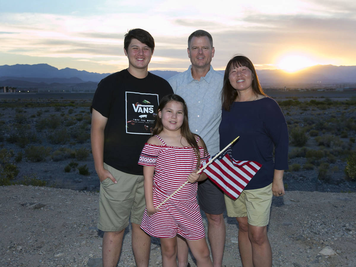 Greg Dawson, center, his wife Yong and their children Zach, 15, and Hailey, 10, on Saturday, Ju ...