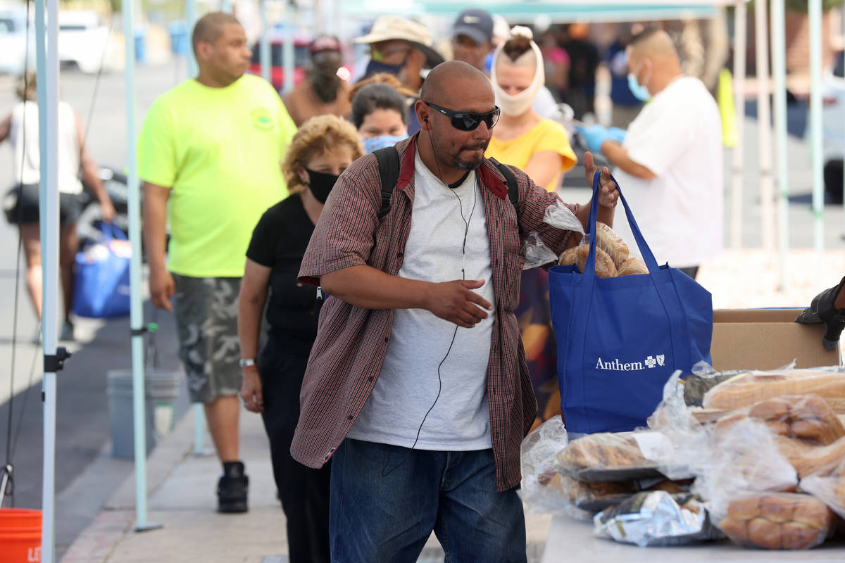 Joaquin Valdez, who said he is homeless in Las Vegas, picks up a food bag at SHARE Village, for ...