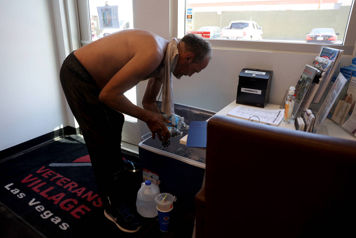 Eric Michael Wynn, 53, grabs water in the front office at SHARE Village, formerly known as Vete ...