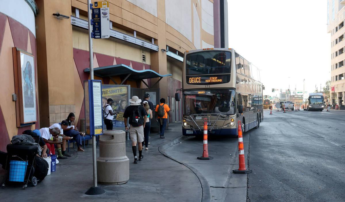 People line up to board a Regional Transportation Commission bus on Las Vegas Boulevard at Frem ...