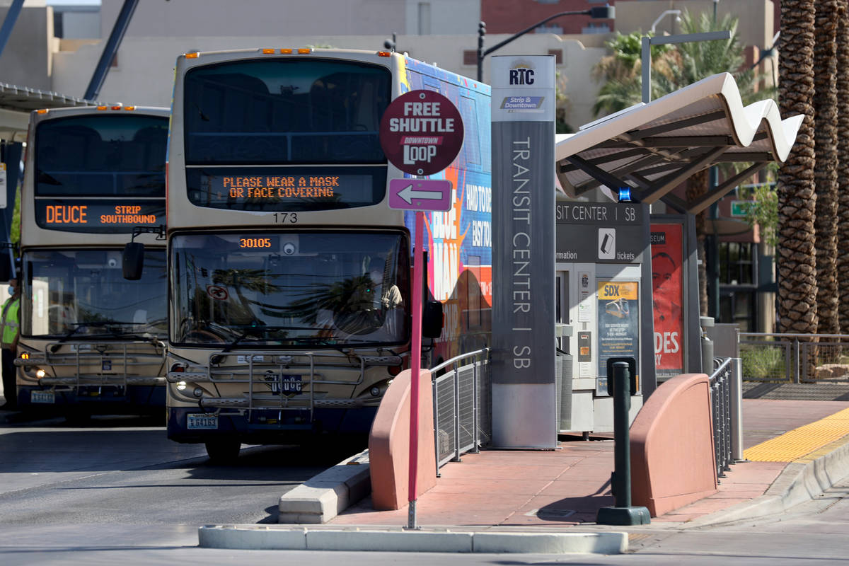 People board a Regional Transportation Commission bus at a stop on Casino Center Boulevard at G ...
