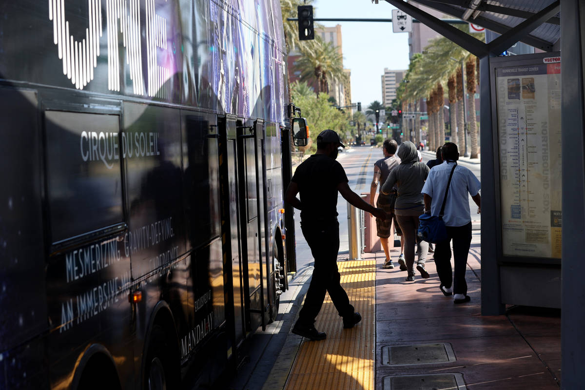 People get off a Regional Transportation Commission bus at a stop on Casino Center Boulevard at ...
