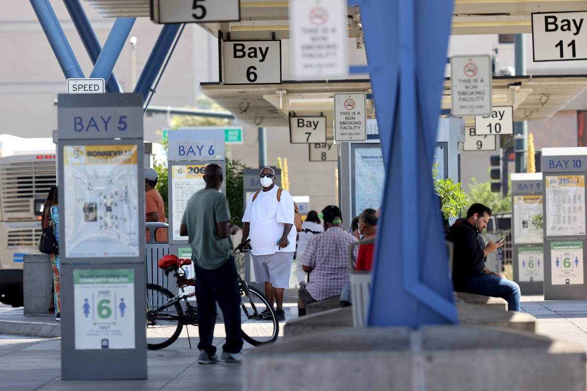 People wait for buses at Regional Transportation Commission Bonneville Transit Center in downto ...