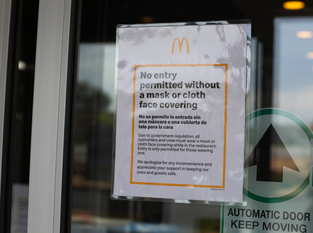 A sign at McDonald's states that masks are required to enter in Las Vegas on Friday, June 26, 2 ...