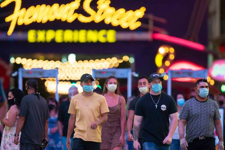Visitors pack the Fremont Street Experience on Thursday, July 2, 2020, in Las Vegas. (Benjamin ...