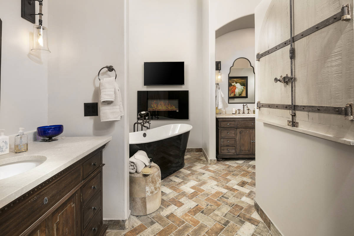 This bathroom's soaking tub and fireplace provide comfort and enhance overall well-being. (Room ...