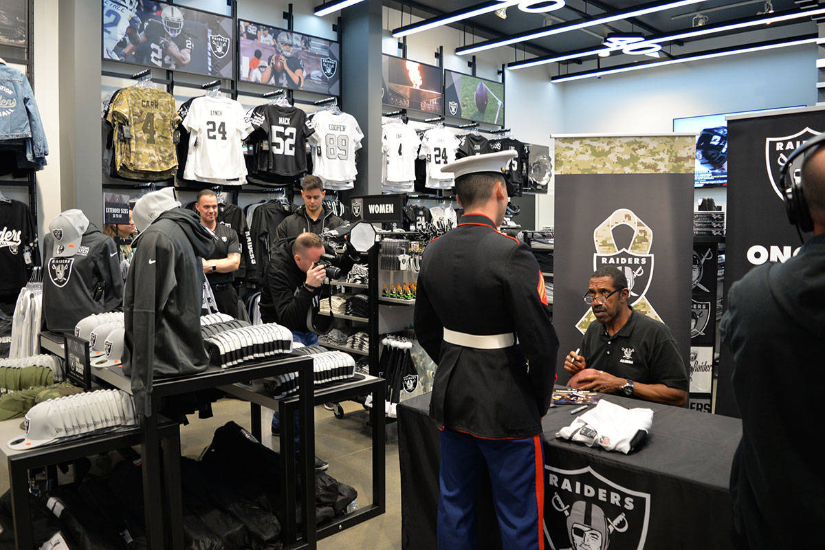 Former Raiders wide receiver Cliff Branch and linebacker Jerry Robinson greeted and signed aut ...