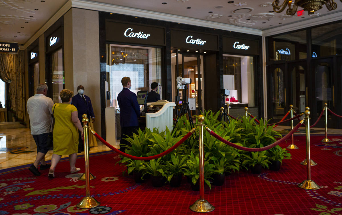 Security guards monitor thermal scanners at the Wynn Las Vegas in Las Vegas on Saturday, June 2 ...