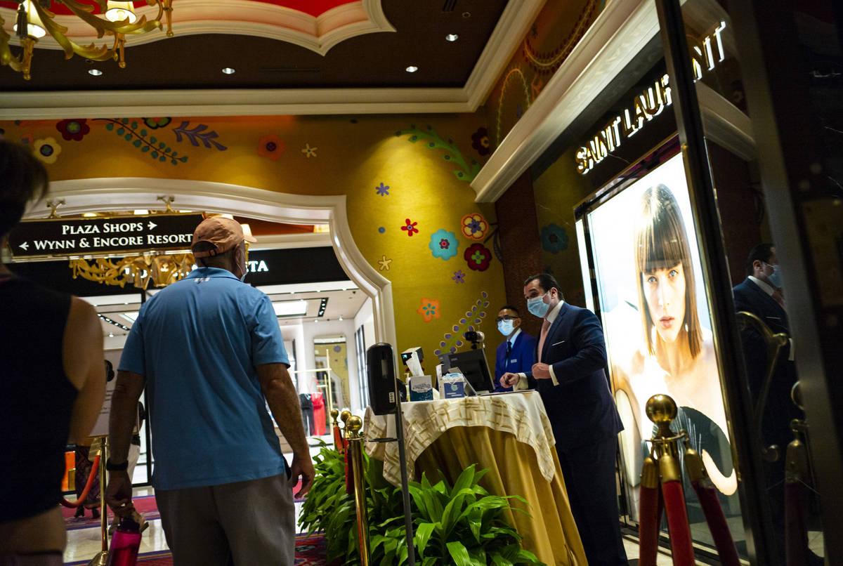People pass through thermal scanners at the Wynn Las Vegas in Las Vegas on Saturday, June 27, 2 ...