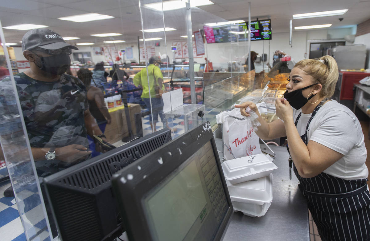 Hot food server Shelley Portillo, right, takes an order at Mario's Westside Market on Wednesday ...