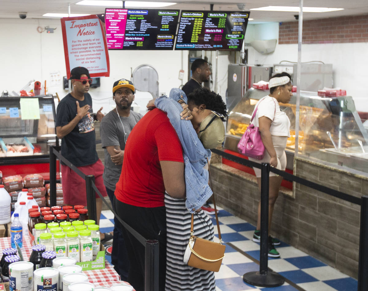 Customers wait in line to order at Mario's Westside Market on Wednesday, June 17, 2020, in Las ...