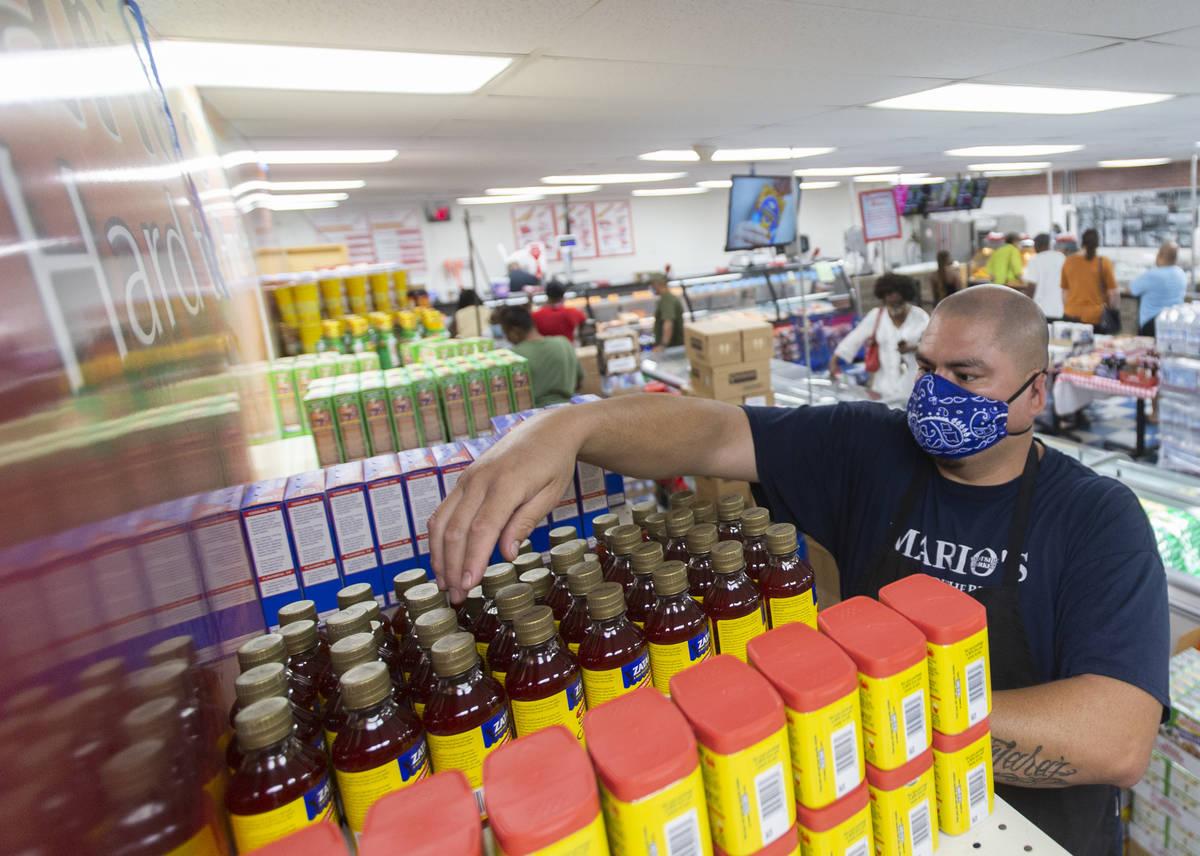 Juan Cisneros stocks shelves at Mario's Westside Market on Wednesday, June 17, 2020, in Las Veg ...