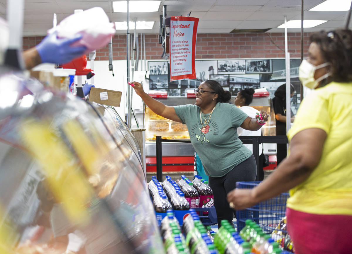 Teresea High, top/left, grabs a ticket at the deli at Mario's Westside Market on Wednesday, Jun ...