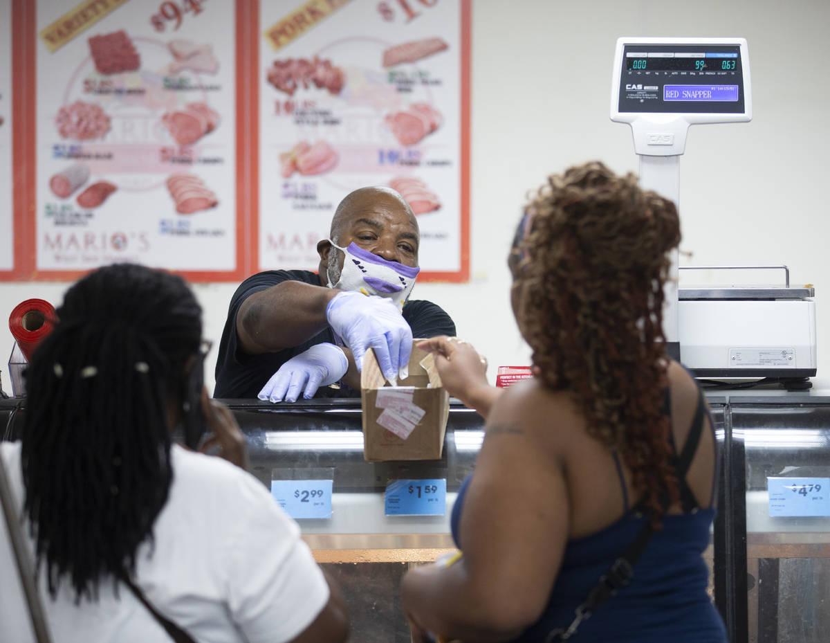 Butcher Mike Lawson, middle, takes a customers order at Mario's Westside Market on Wednesday, J ...