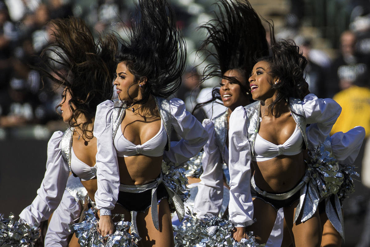 The Raiderettes perform during a break in the first quarter of an NFL football game with the Ja ...