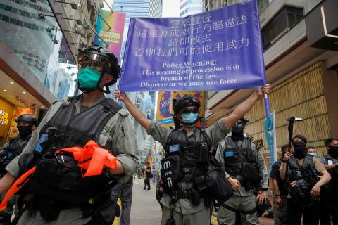 Police display a public announcement banner showing the warning to protesters in Causeway Bay b ...
