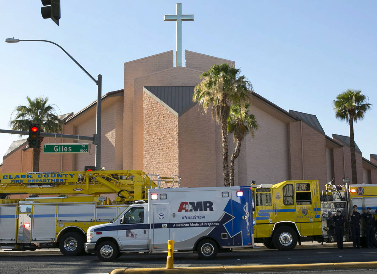 An ambulance carrying a wounded Las Vegas police officer Shay Mikalonis drives past Shrine of T ...