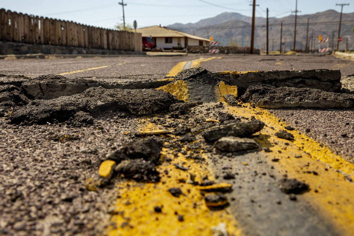 Extensive cracks with shifting pavement have opened up and forced road closures in Trona, Calif ...
