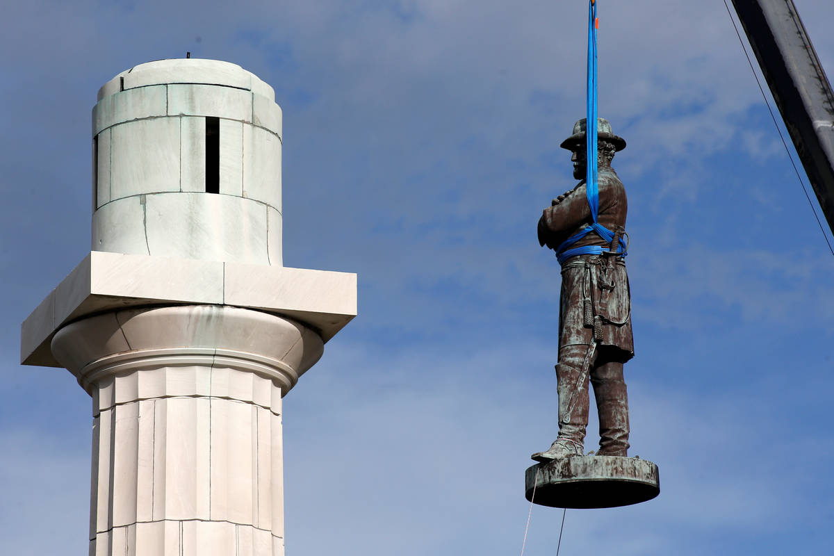 A monument of Robert E. Lee, who was a general in the Confederate Army, is removed in New Orlea ...