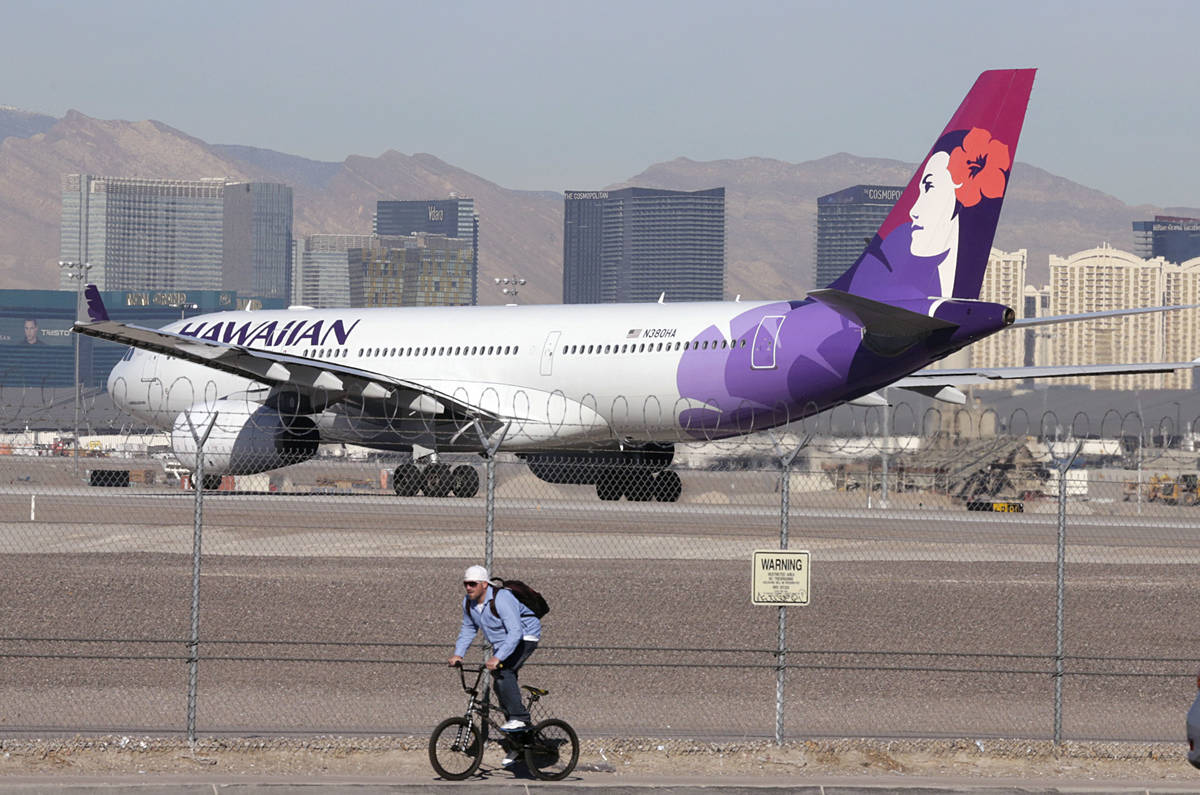 A Hawaiian Airlines plane prepares to take off from McCarran International Airport on Wednesday ...