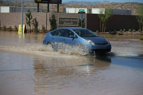 A person drives near the intersection of Gomer Road and Cumberland Ranch Avenue across from the ...