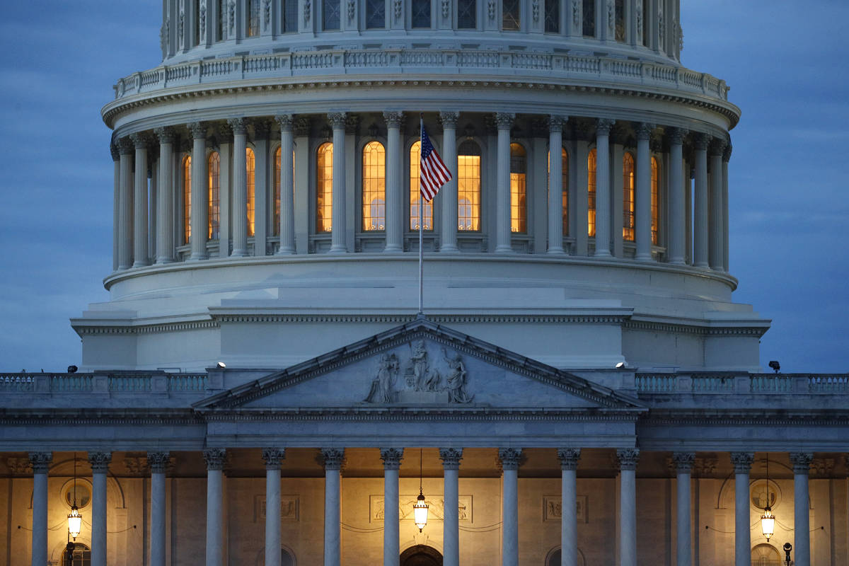 FILE - In this May 3, 2020, file photo, light shines from inside the U.S. Capitol dome at dusk ...