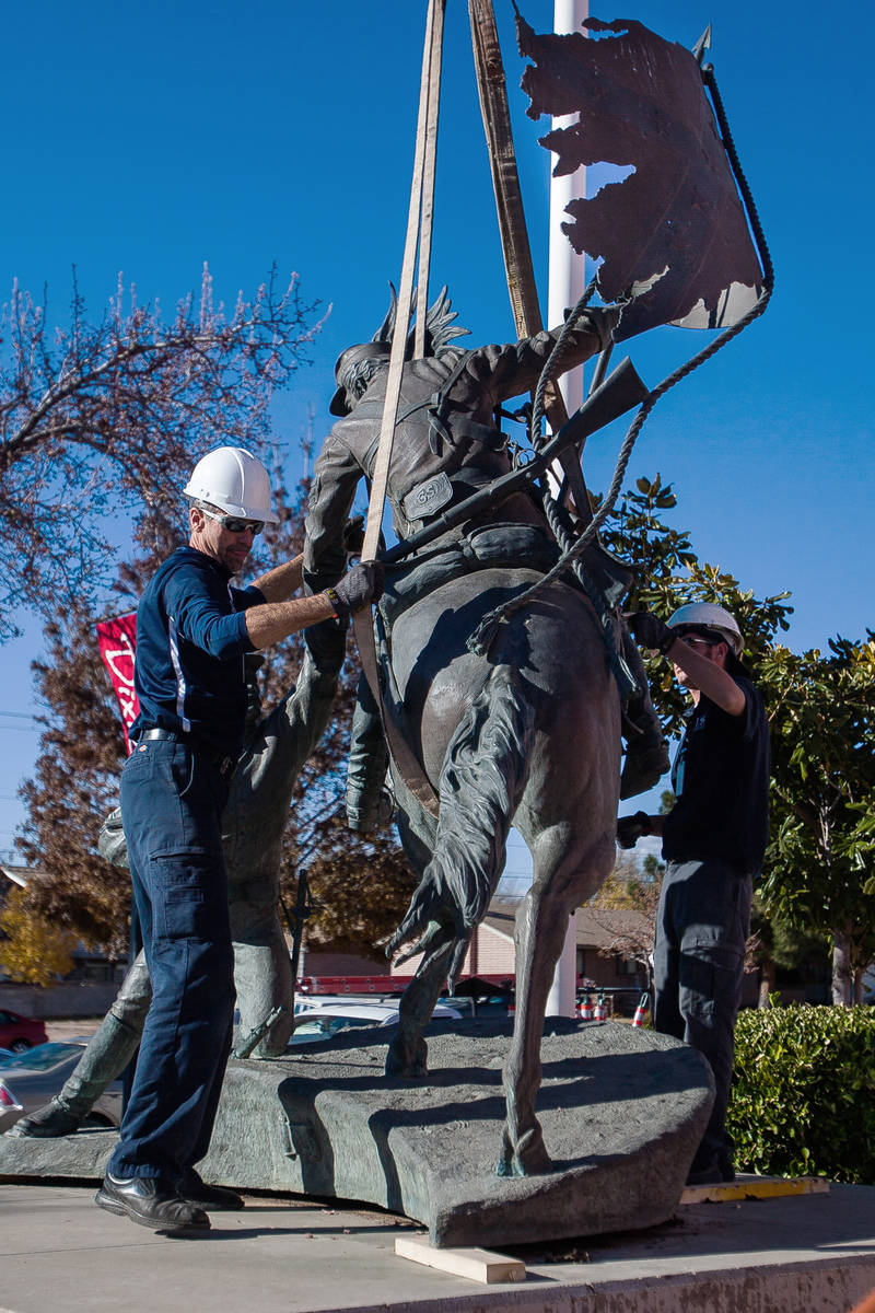 In this Dec. 6, 2012, file photo, workers remove a statue depicting two Confederate soldiers, i ...