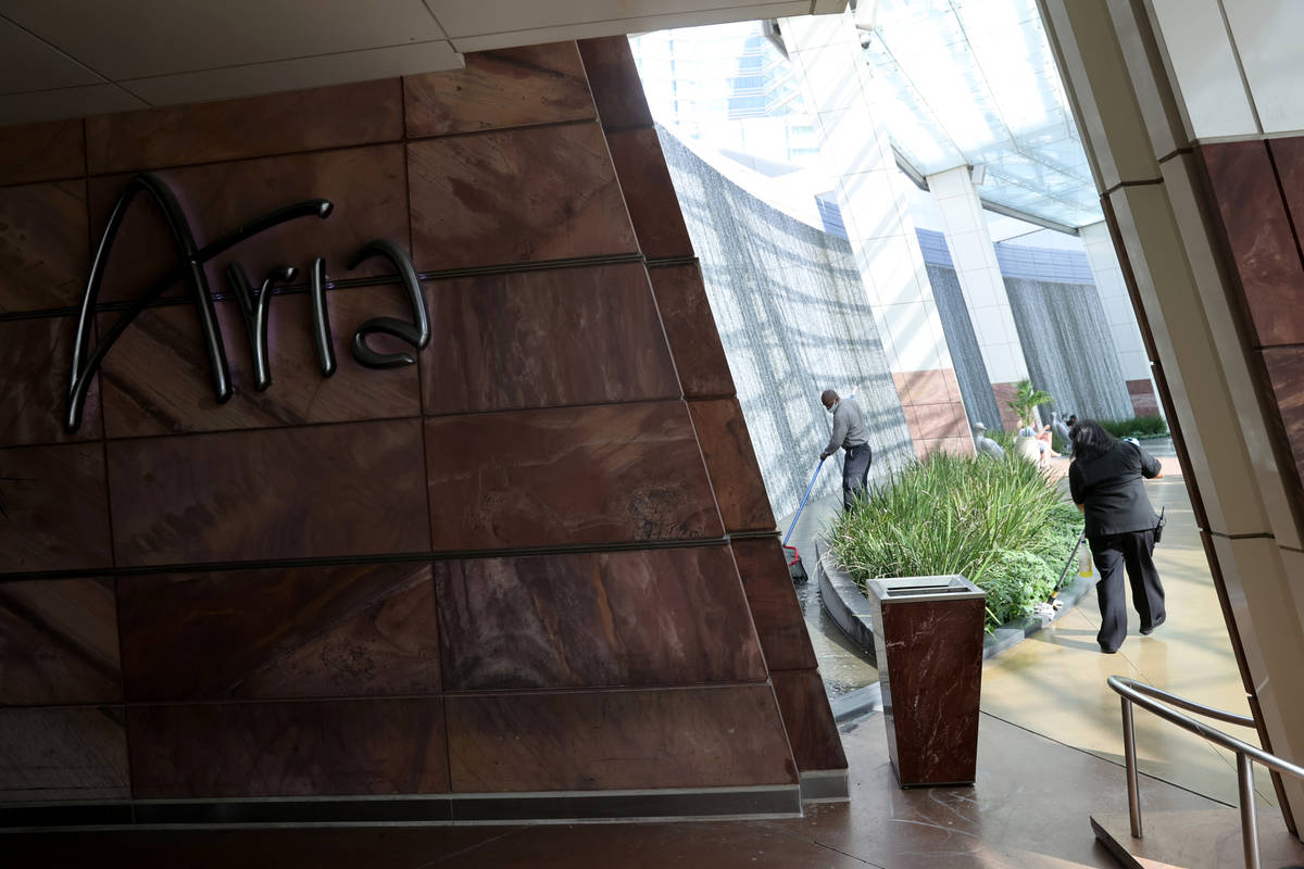 Workers put the finishing touches on Aria on the Strip in Las Vegas before reopening Wednesday, ...