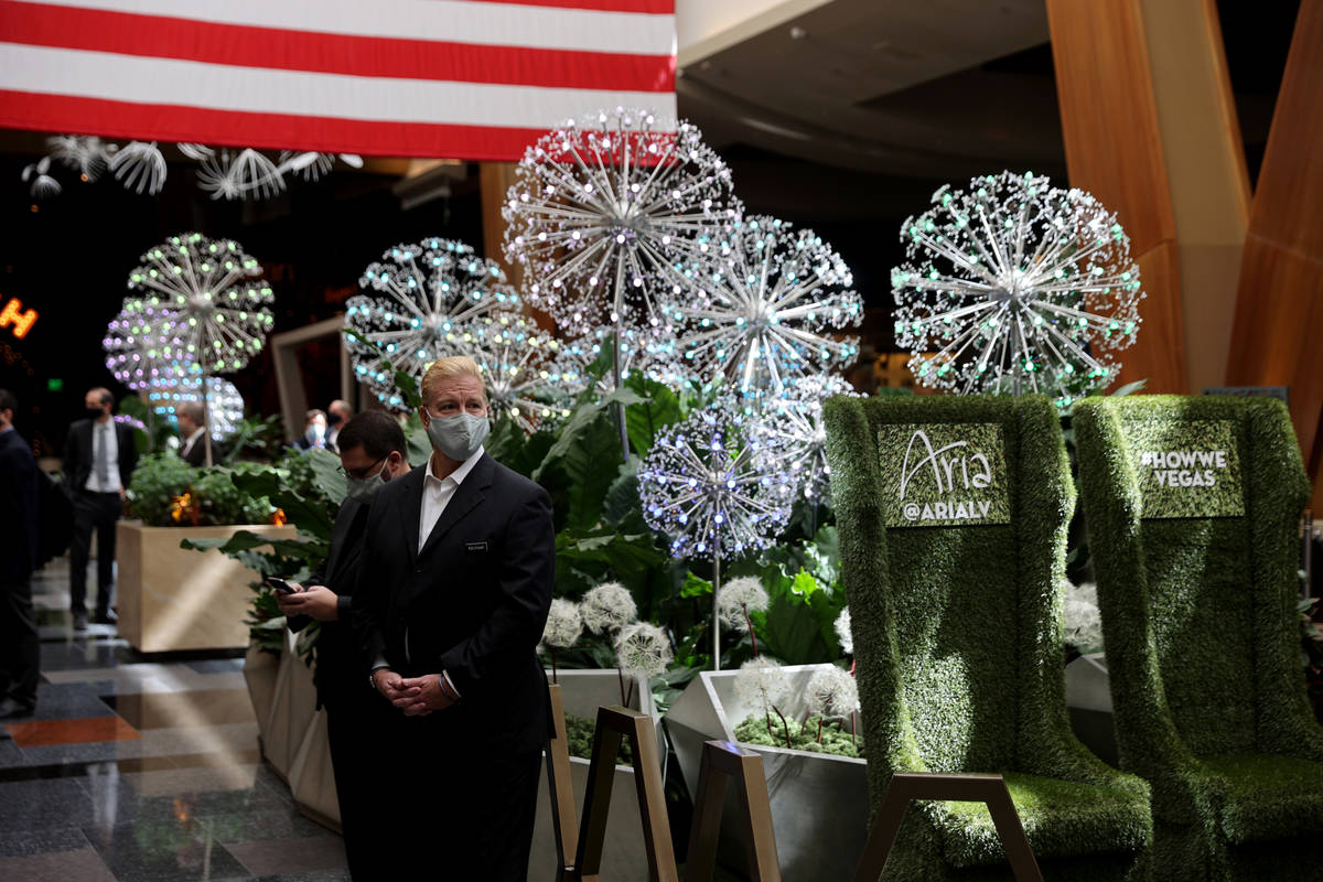 """Employees with the summer lobby display """"Dandelion Forest"""" at Aria on the Strip in Las Vega ..."""